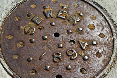 Aging sewer system manhole cover
