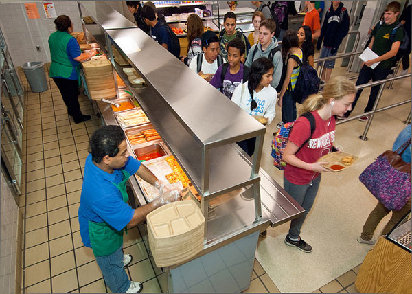 Students and workers in a school cafeteria