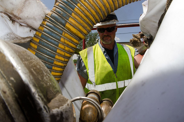 Worker repairs sewer lines